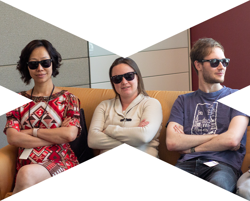 group of three mx employees sitting on couch with sunglasses