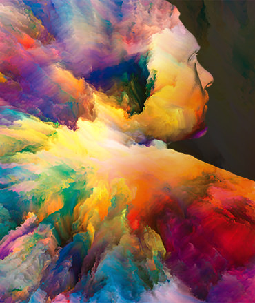 multicolor paint swirling together into the silhouette of a man