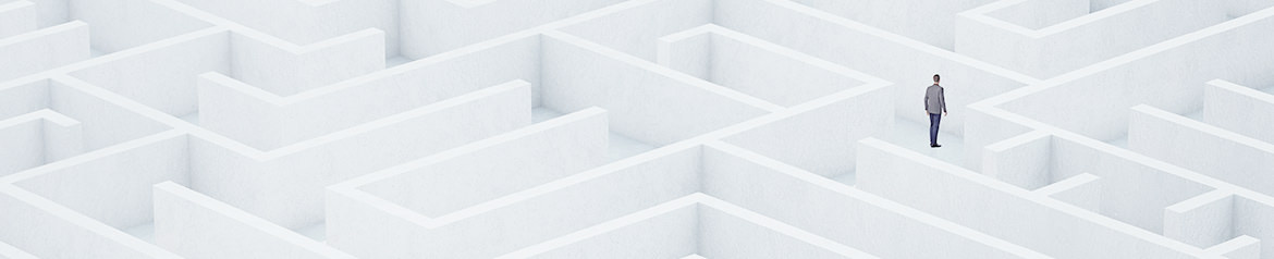 A person in a suit standing alone in a large, complex white maze representing a poor digital experience for b2b buyers.