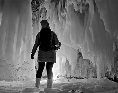 Video screenshot of a person in an ice cave