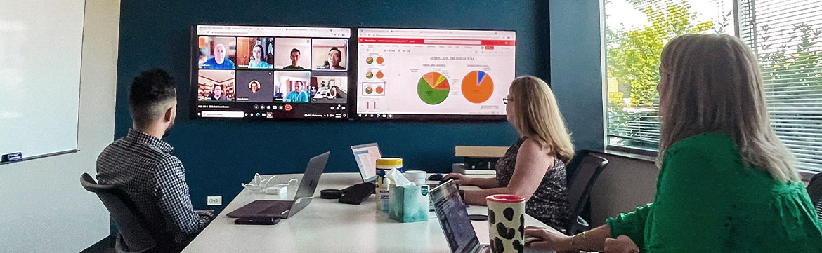 Mx employees in a hybrid meeting
